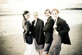 Wearing the groom/groomsmen's suit jackets, because it was a bit cold!