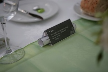 Place setting: I found a different love-related quote for every guest. Menus were rolled up inside the place setting.