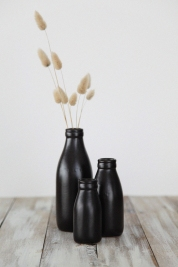 milk bottle vases in black, by pbaigent on felt.co.nz