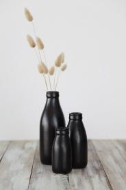 milk bottle vases in black, by pbaigent on felt.co.nz