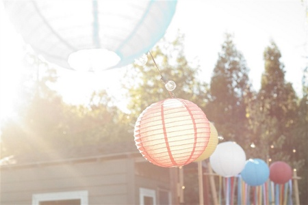 Paper lanterns are a cheap but lovely way to light your backyard