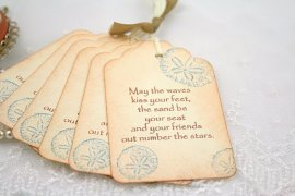 Sand dollar tags, by seasonaldelights on etsy.com