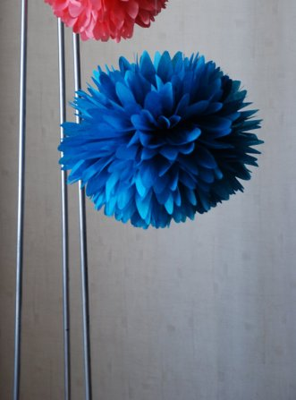 Tissue paper pompoms, by ThePomQueen on etsy.com