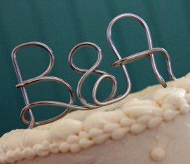 Silver custom monogram cake topper, by deliziare on etsy.com