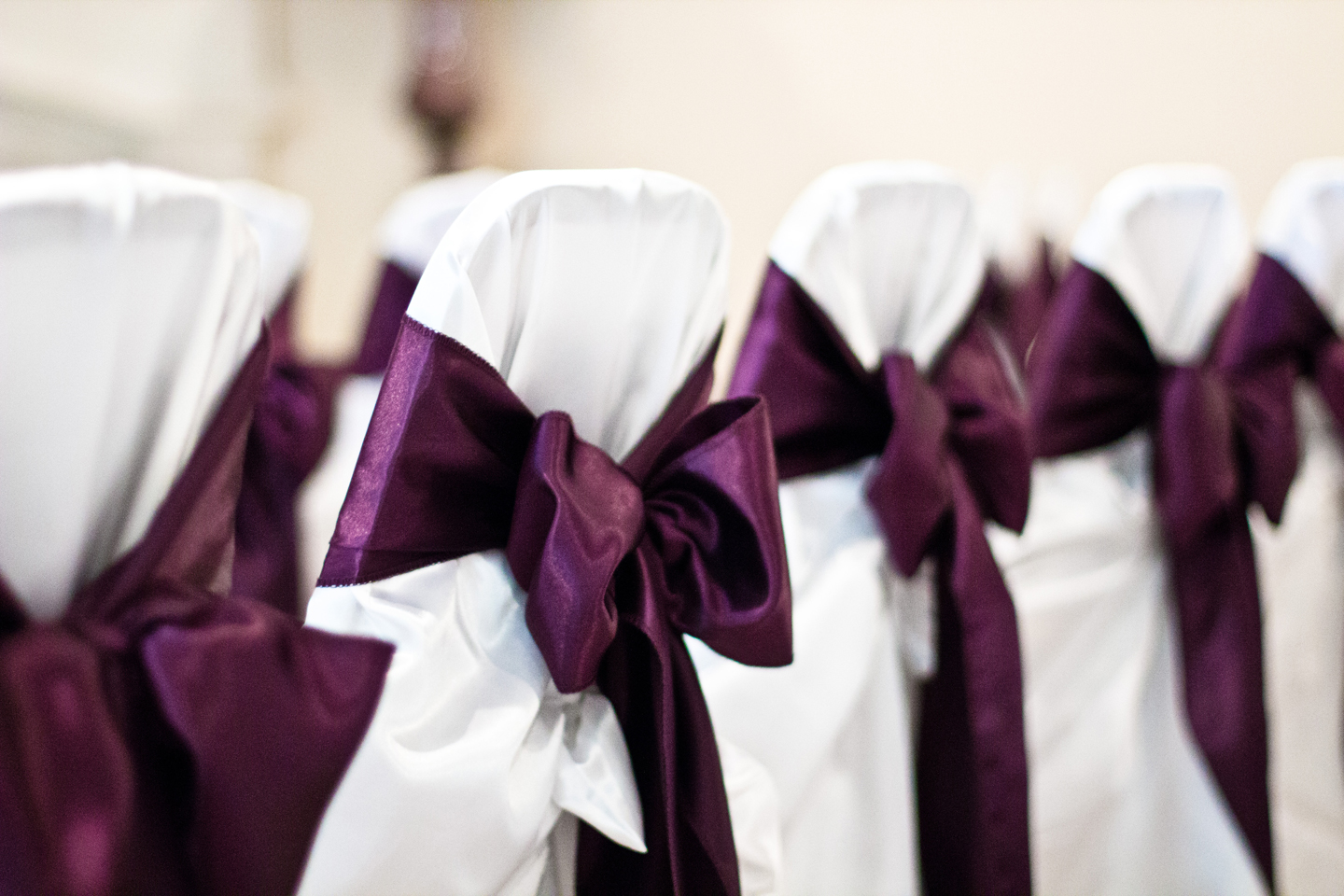 Published December 12 2012 at 1440 × 960 in ... & Eggplant-coloured bows on chairs at a reception | The Merry Bride