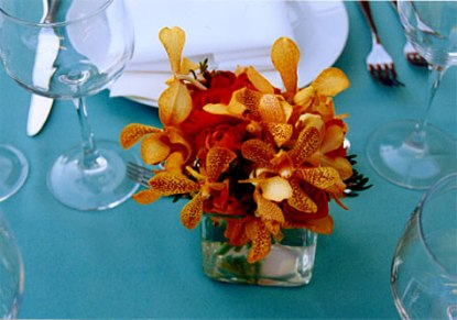 Table setting in orange and turquoise