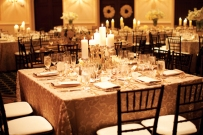 Wedding reception in black, white and antique-gold