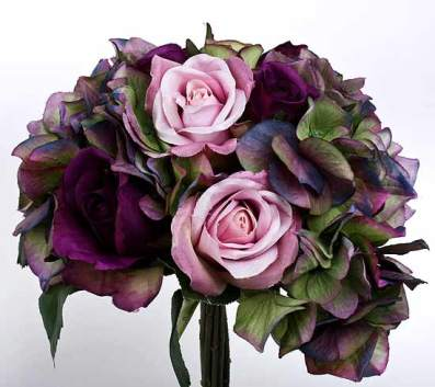 A bouquet in shades of sage and purple roses and hydrangeas