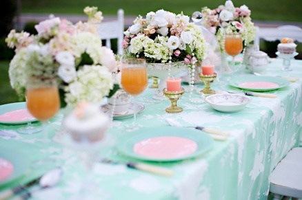 A table set up in mint and peach colours