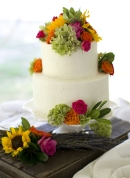 Amy Smart and Carter Oosterhouse's wedding cake was decorated with sunflowers, roses and green hydrangeas