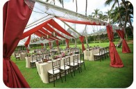 An outdoor pink and red wedding reception