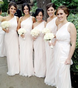 Ashley Hebert's bridesmaids wore Grecian-style light pink dresses by Badgley Mischka