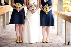 Bride and bridesmaids in navy and yellow colour scheme