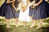 Bride and bridesmaids in navy and yellow