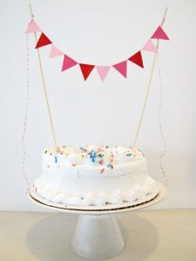 Cake bunting, by AthenaandEugenia on etsy.com