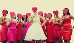 Cheeky photo! Bridesmaids in red and pink