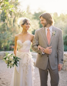 Groom in a grey suit with coral tie