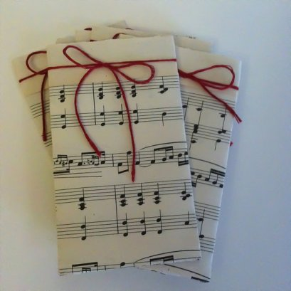 Music sheet cutlery holders, by FullOfYears on etsy.com