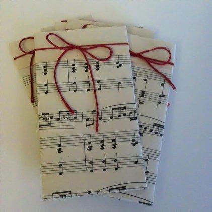 Music sheet cutlery holders, by FullOfYears on etsy.com