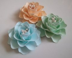 Paper flowers (available in many colours), by morepaperthanshoes on etsy.com