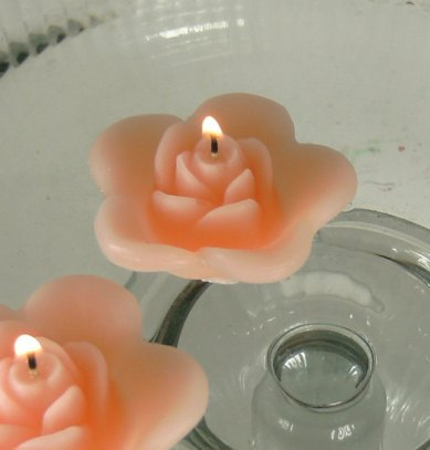 Peach rose floating candles (for centrepieces), by GlowliteCandles on etsy.com