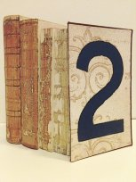 Vintage book centrepieces, by beachbabyblues on etsy.com