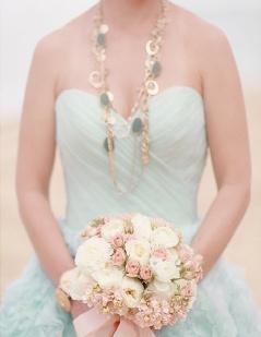 Bride in a mint-green wedding dress