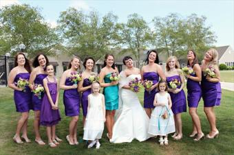 Bridesmaids in purple; maid of honour in turquoise