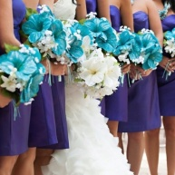 Bridesmaids in purple with turquoise bouquets