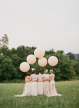 Bridesmaids with giant balloons