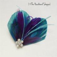 Feather fascinator, by TheHeadbandShoppe on etsy.com
