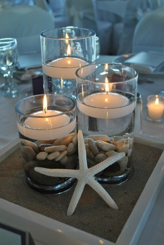 Floating candles as part of a beach wedding centrepiece