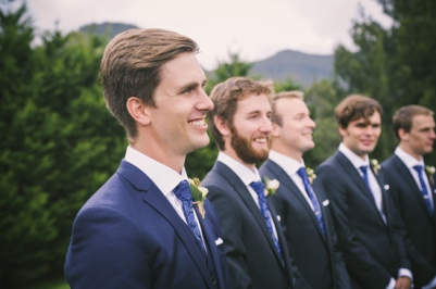 Groom in a navy suit