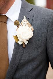 Groom with a burlap and lace boutonniere