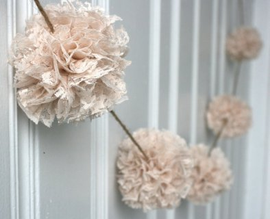 Lace pompom garland, by ThreadingMarigolds on etsy.com