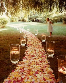 Petal and hurricane vase aisle