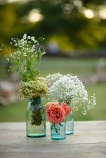 Rustic flower and vase centrepieces