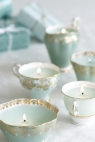 Tealight candles in mint and gold teacups