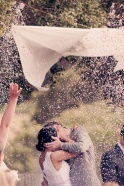 """When the officiant says, """"kiss the bride"""" the maid of honour and best man pull the string and petals fall."""