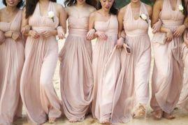 Bridesmaids in blush-coloured dresses