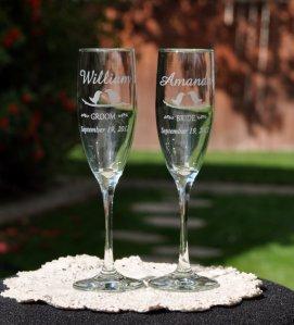 Personalised champagne flutes, by DesignImageryEngrav on etsy.com