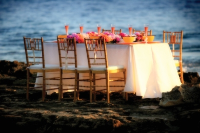 Beach wedding reception in coral and yellow tones