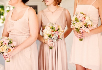 Bridesmaids in different blush dresses