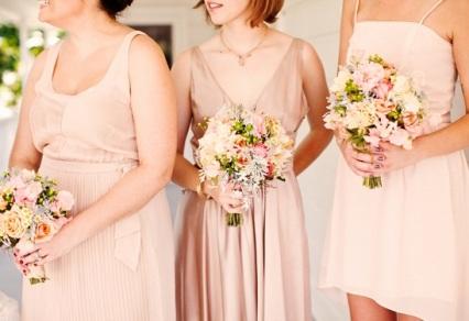 Bridesmaids in different blush dresses