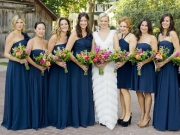 Bridesmaids in midnight-blue at Amy Smart's wedding
