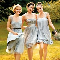 Bridesmaids in mismatched silver dresses