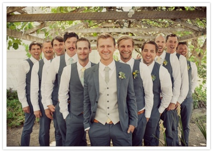 Groom in vest and jacket, groomsmen just in vests