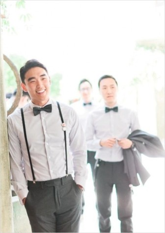 Groom with suspenders and bow-tie