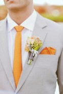 Light grey suit with orange tie and pocket square