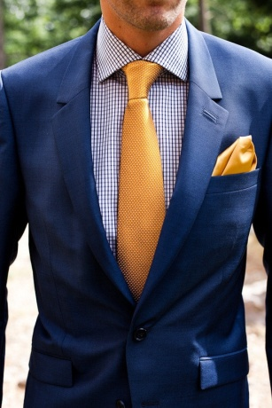 Navy suit with gold tie